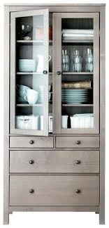 ikea hemnes glass door cabinet on the wall just outside the kitchen for crystal and pretty dishes