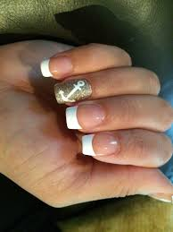 pretty french mani with a glitter and anchor accent nail done by