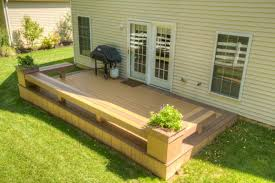 low deck with benches and flower boxes decks and gardens