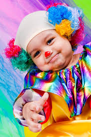 two cheerful clowns birthday children bright stock photo a kid wearing clown clothes stock photo image of isolated