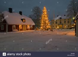 swedish country house with a big illuminated christmas tree in