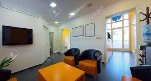 waiting room interior of a dental clinic in orange and white
