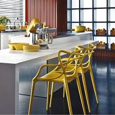 masters chairs in mustard by philippe starck for kartell let your