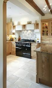 the aga rangemaster elan range cooker in a country style kitchen