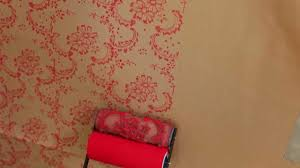the painted house using the wall and paper applicator on fabric