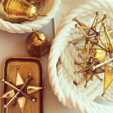 8 things you can t live without in 2017 home decor trends gold brass trends star home decor nautical mirror