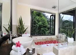 Tropical Themed Bathroom Ideas Tropical Bathroom Decor Cream Ceramic Bathtub Cream Ceramic Tile