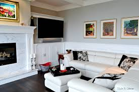 living room with built in tv cabinet marble fireplace surround