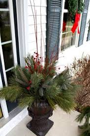 Decorate Outside Urn Christmas by Let The Holiday Decorating Begin Winter Christmas Porch And