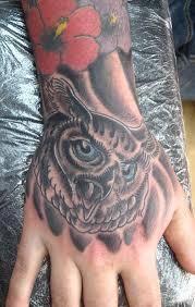 irish street tattoo owl hand irish st tattoo
