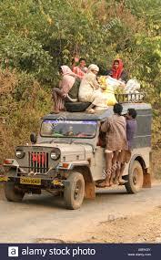 desia kondh tribal people load on a jeep for their weekly market