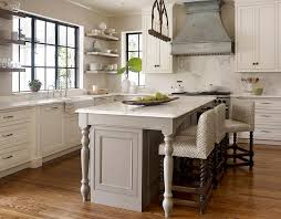 kitchen islands with legs transitional kitchen features an iron linear chandelier