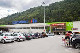 carrefour si e social the parking place before entrance to big carrefour market editorial