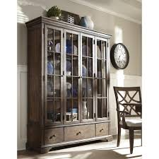 Curio Cabinets Shelves Monticello Curio Cabinet With Additional Drawer Storage And Paned