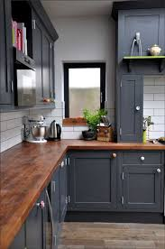 light grey kitchen cabinets with wood countertops 10 benefits of wood countertops