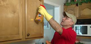 best way to clean kitchen cabinets how to remove grease from kitchen cabinets today s homeowner