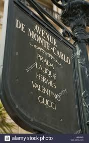street sign for luxury designer shops on avenue de monte carlo in