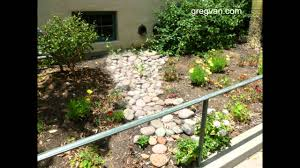 how to use rocks to reduce soil erosion walkways and landscaping
