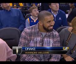 drake attends warriors vs okc thunder wearing ovo shirt air