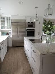 river kitchen island white cabinets gray island river white granite gray subway tile