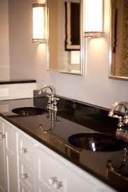 Vanity With Granite Countertop The Master Bathroom Has Black Granite Countertops With Double