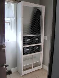 Storage Laundry Room by Remodelaholic Laundry Room Makeover With Personalized Hanging