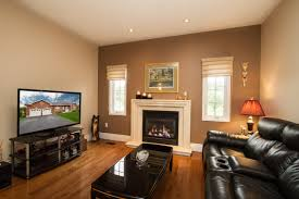 real estate interior photography purple door creative a photo of a formal living room with a gas fireplace by purple door creative