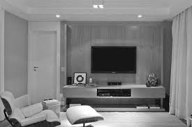 modern wooden floating tv shelves attached on bricks stone wall of