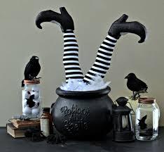 easy diy witch feet in cauldron halloween decoration rachel teodoro