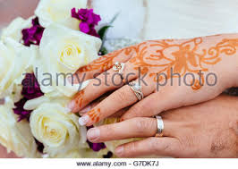 bride u0027s hand with henna tattoo and jewellery indian wedding stock