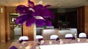 purple centerpieces purple and white feather centerpieces