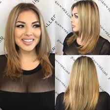 women s razor cut layered blowout with face framing layers and