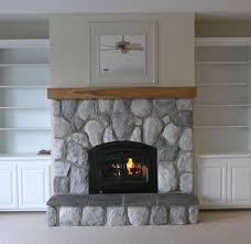 interior dark brown wooden fireplace mantels floating on grey