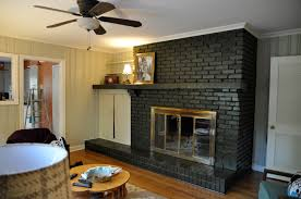 enjoyable dark brick painted fireplace with floating shelf as