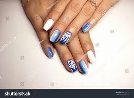 beautiful manicure gel polish coating blue stock photo 490333774