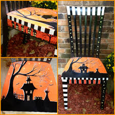 a halloween chair that i painted to sell at my booth for halloween