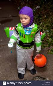 young boy in buzz lightyear halloween trick or treater costume st