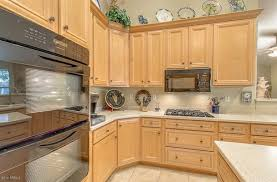 yellow kitchen wood cabinets what type of wood cabinets are these beech or maple