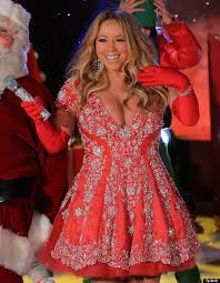 mariah carey braves the cold in cleavage busting dress at