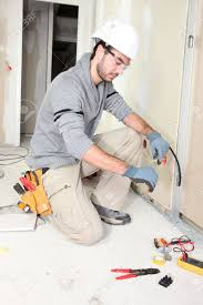 electrician wiring a house stock photo picture and royalty free