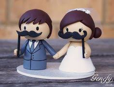 mustache cake topper and groom with moustache prop sticks wedding cake