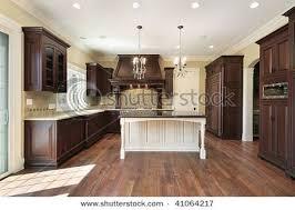 wood kitchen cabinets with white island i like the idea of mixing wood white cabinets kitchen