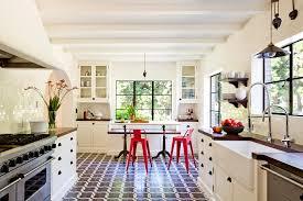 brick pattern tile kitchen mediterranean with arch black pulls