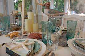 themed tablescapes themed table setting with sailboat napkin fold and shell
