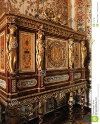wooden furniture with ornaments at versailles palace editorial