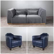 canapé velours gris canapé velours gris et deux fauteuils en cuir bleu vintage patiné