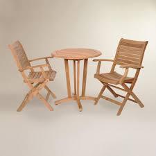 tanjun teak outdoor bistro set with folding armchairs world market