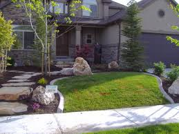 Small Yard Landscaping Pictures by Interior White Chair Front Brick Wall For Small Yard Landscaping