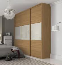 beautiful classic three panel sliding wardrobe doors in oak and