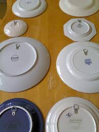 tired of expensive hangers to display your plates on walls click